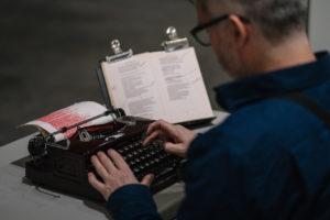 Closeup view of Tim Youd during his typewriter performance